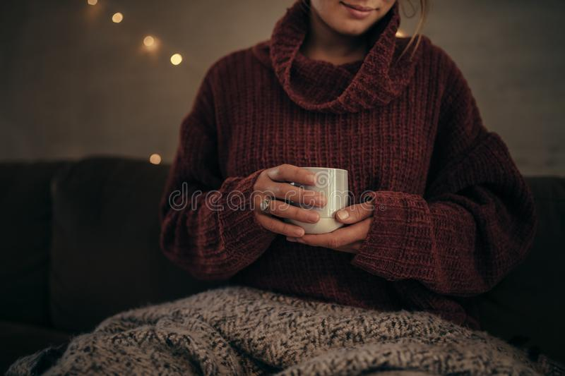 Woman having coffee in winter at home stock images