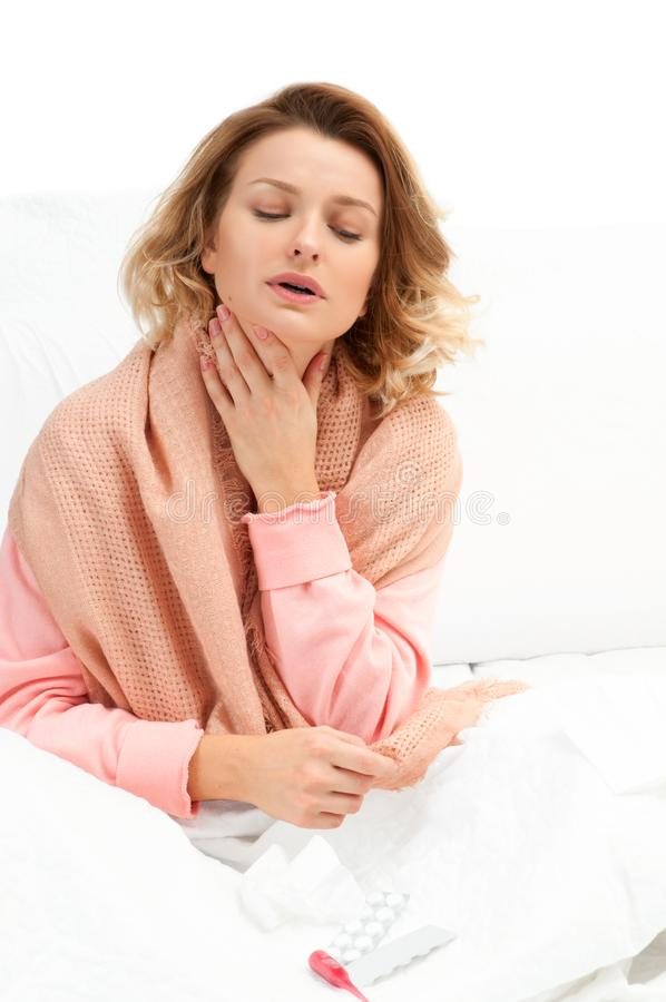 Woman having a cold, flu. Sore throat and coughing stock photos