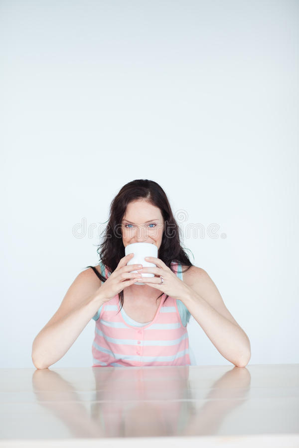 Woman having a cup of coffee royalty free stock photos