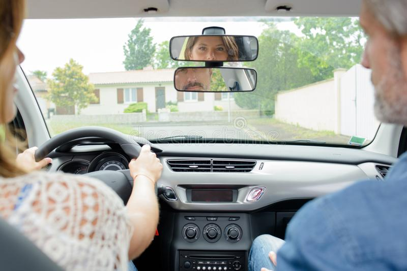 Woman having driving lesson royalty free stock photo