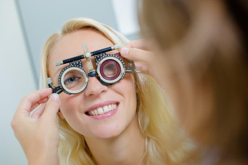 Woman having eye test stock photos