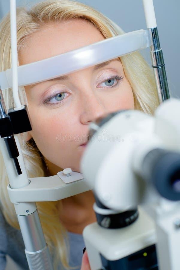 Woman having eye test royalty free stock photography