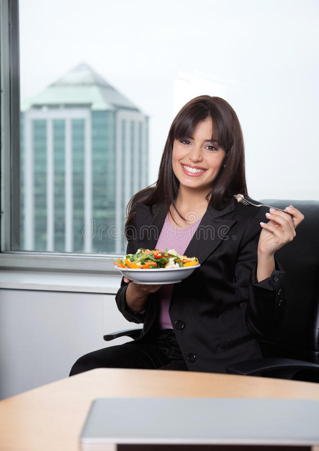 Woman Having Fresh Salad of Vegetables stock images