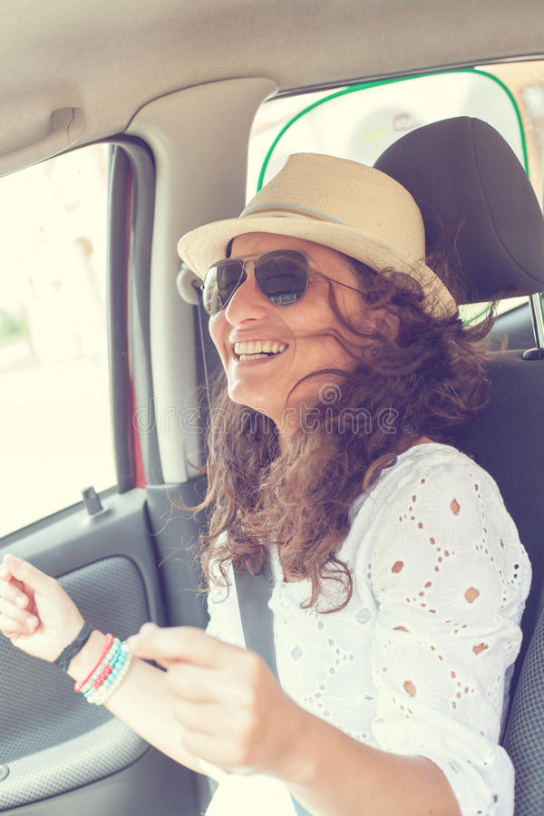 Woman having fun in the car stock image