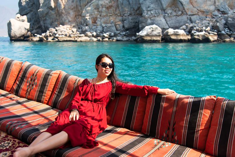 Woman having fun on a dhow boat cruise stock images