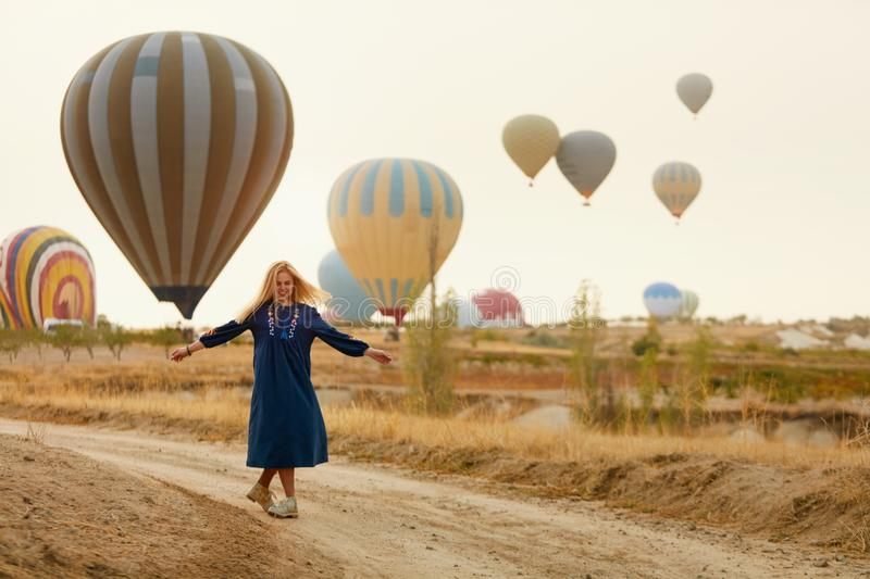 Woman Having Fun With Flying Hot Air Balloons On Background royalty free stock image