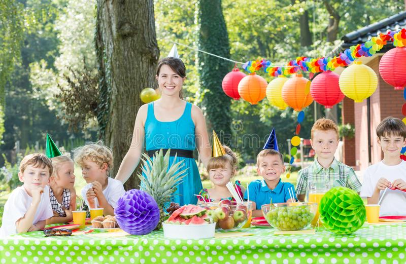 Woman having fun with kids royalty free stock photography