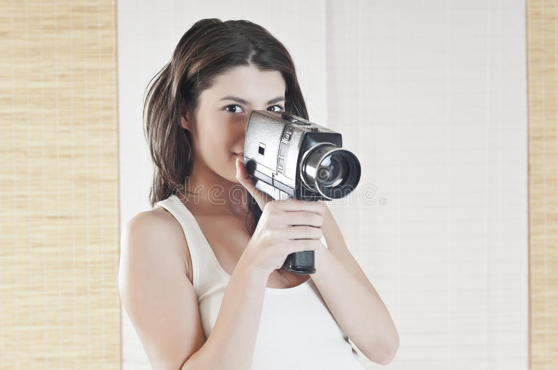 Woman Having Fun With An Old Camera Royalty Free Stock Photos