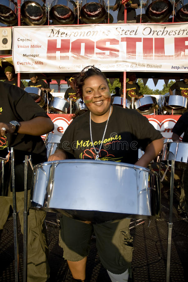 Download A Woman Having Fun And Playing Steel Drums Editorial Photography - Image: 10788492