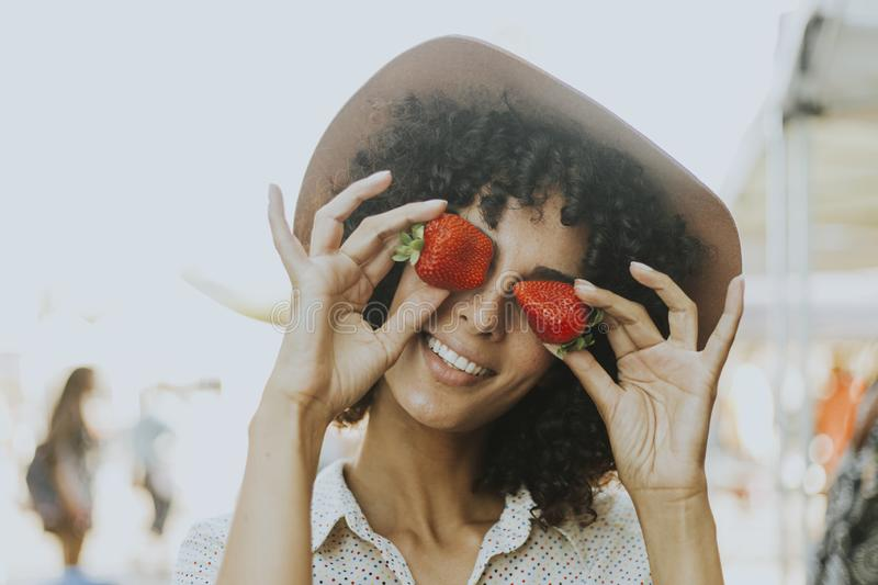 Woman having fun with strawberries royalty free stock photos