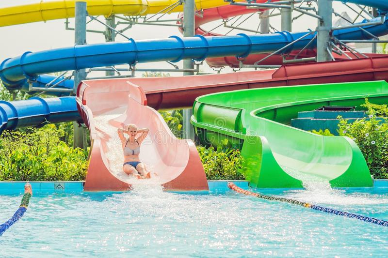 Woman is having fun in the water park royalty free stock image