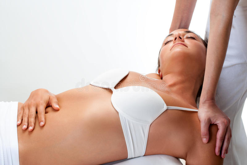 Woman having healing massage. stock photography