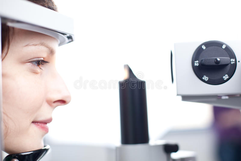 Woman Having Her Eyes Examined By An Eye Doctor Stock Photos