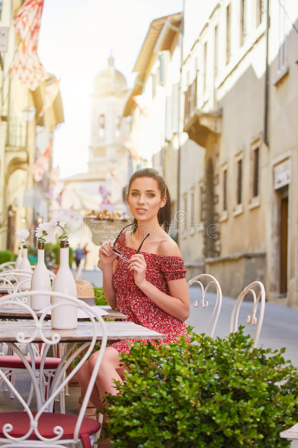 woman having italian coffee at the cafe on the street in Toscana city. Soft focus with small depth of field stock photo