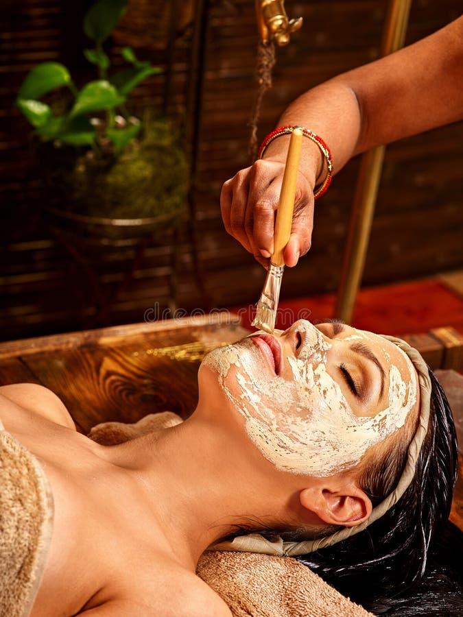 Woman having mask at ayurveda spa stock photo