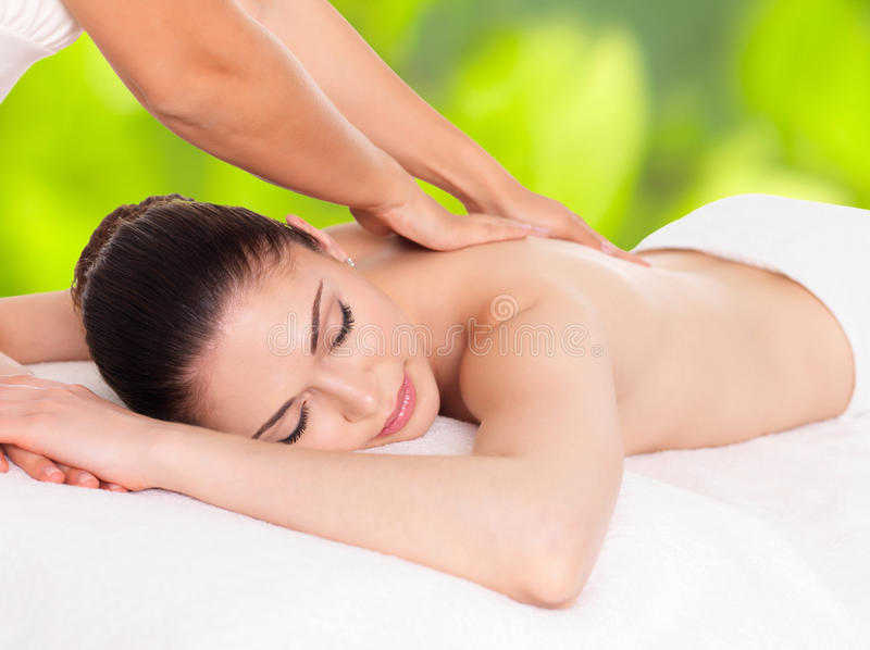 Woman having massage of body in nature spa royalty free stock photo