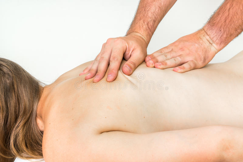 Woman having massage in spa salon stock images