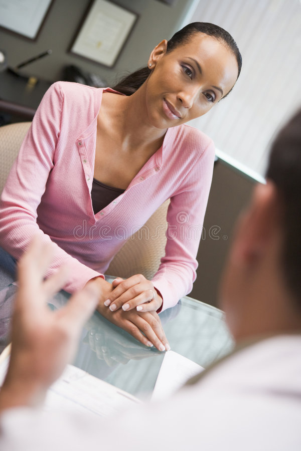 Woman having meeting with doctor in IVF clinic stock photos