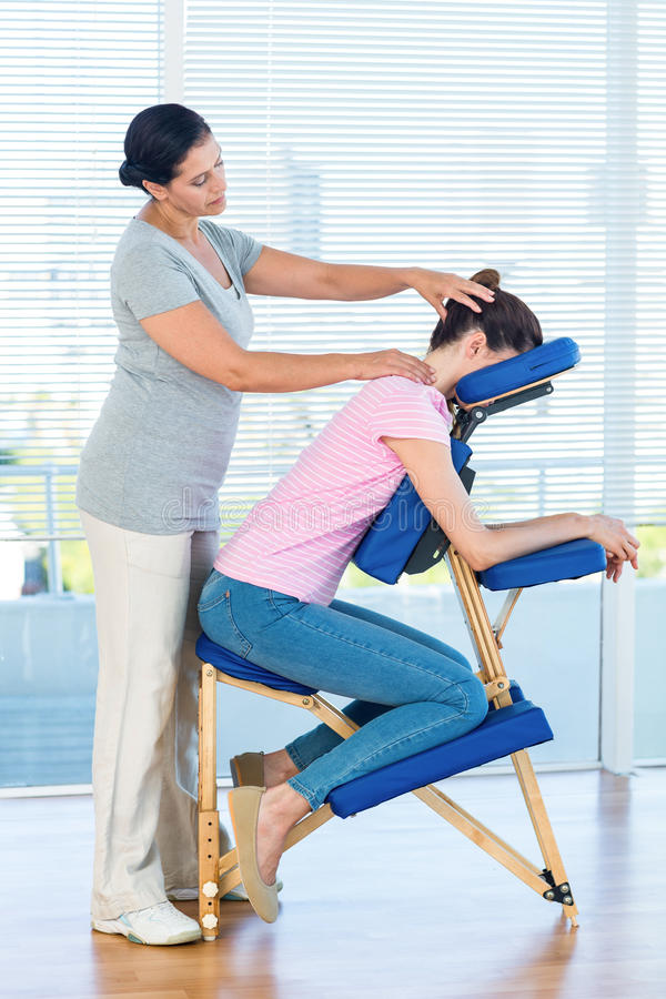 Woman having neck massage. In medical office stock photos