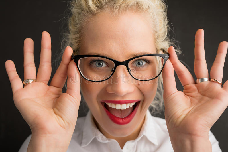 Woman having new glasses stock image