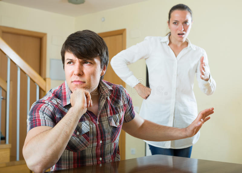 Woman having problems with her husband. Sad russian women having problems with her husband at home royalty free stock photography