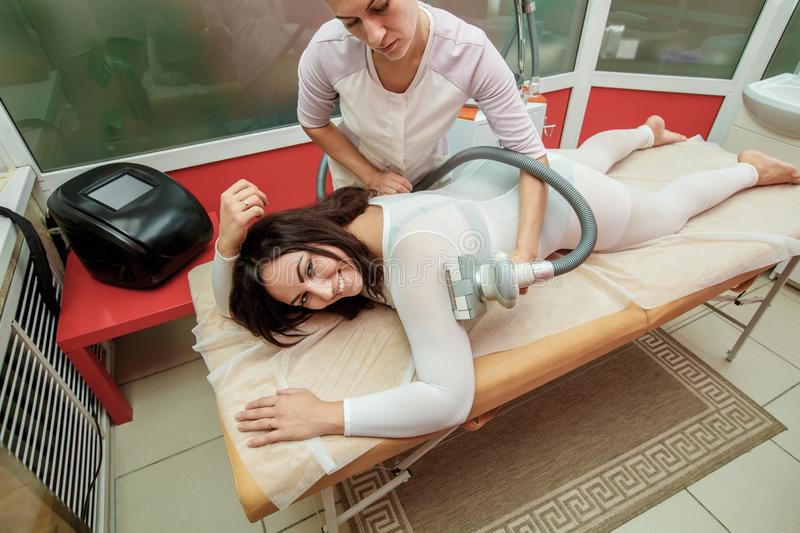 Woman having procedure of anti cellulite lpg massage, cosmetology clinic stock photos