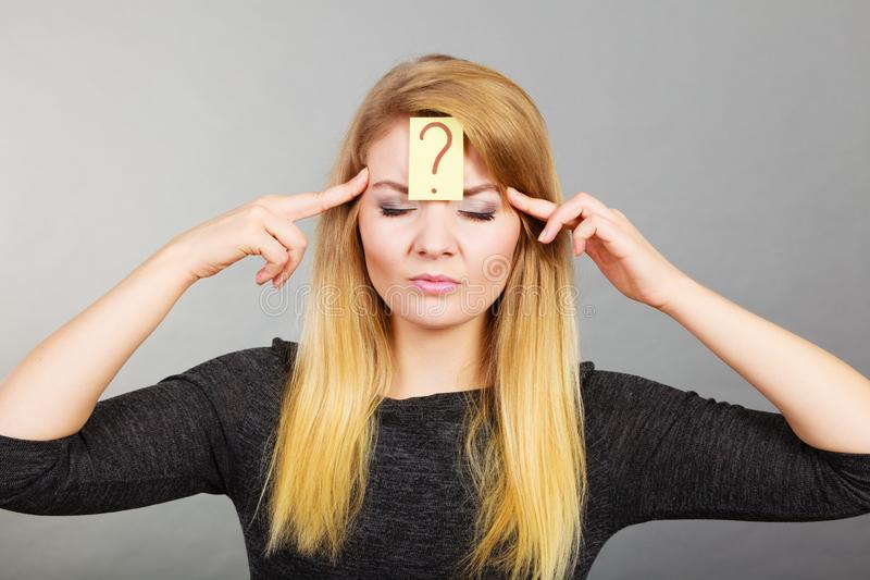 Woman having question mark on forehead stock images