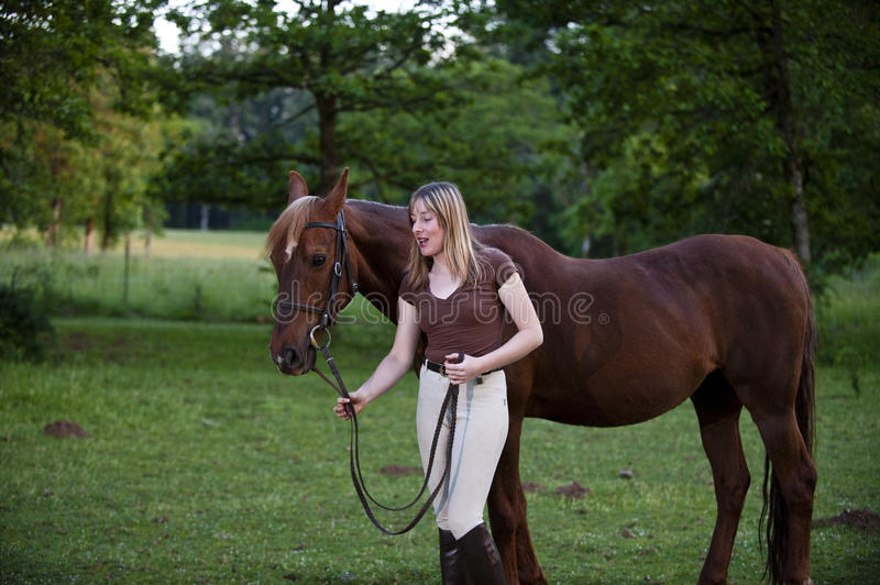 Woman having a quiet moment with her horse royalty free stock image