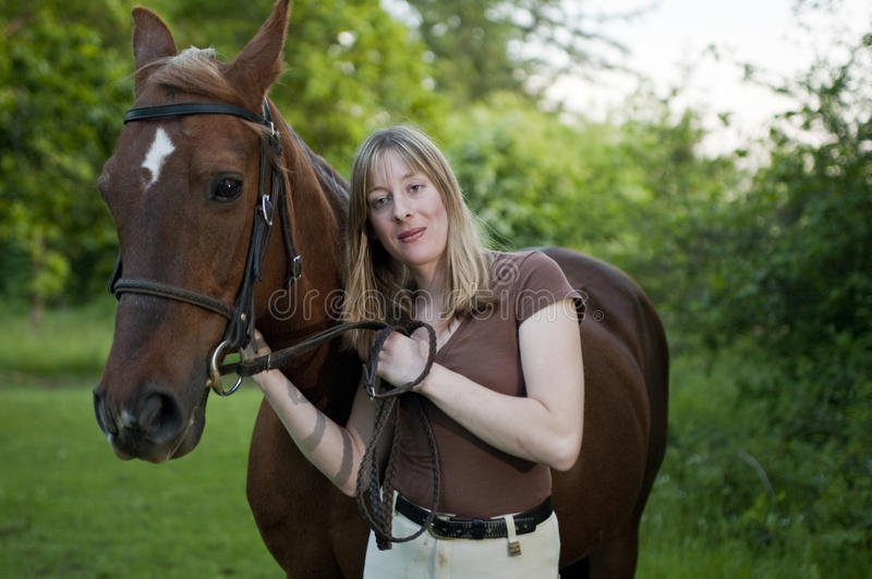 Woman having a quiet moment with her horse stock photos