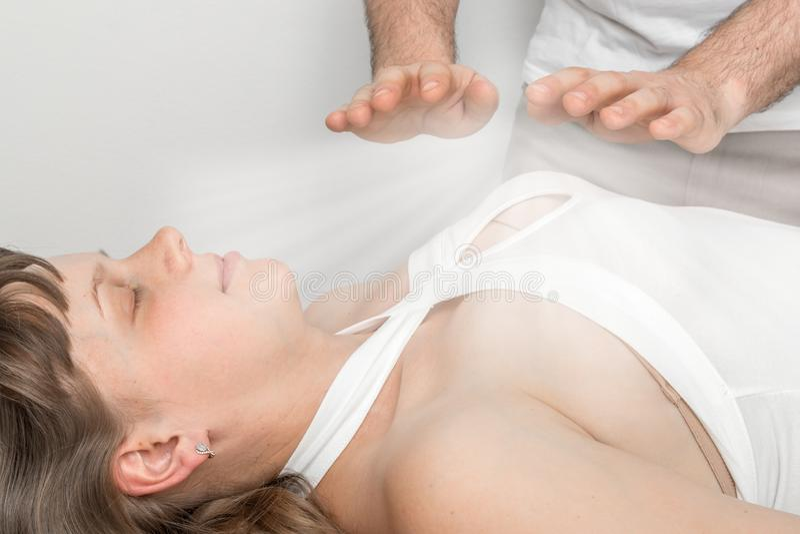 Woman is having reiki healing treatment. Alternative medicine concept stock photos