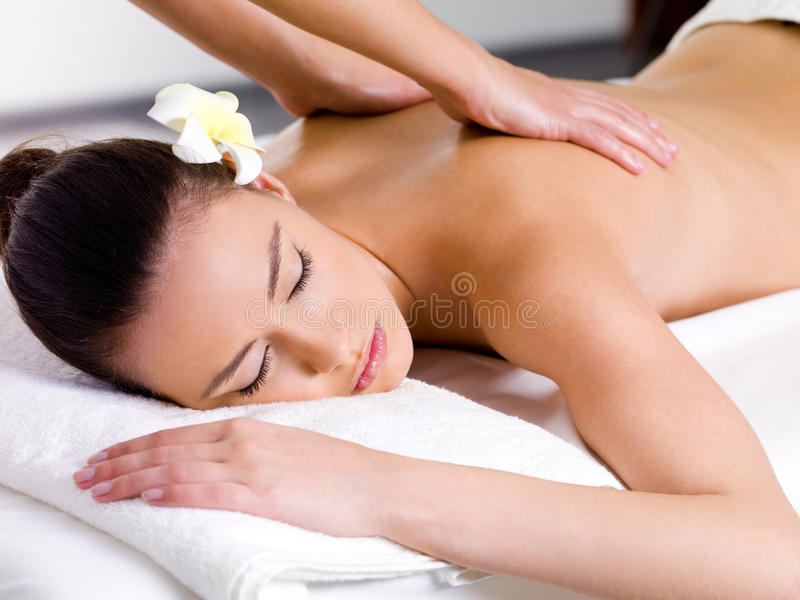Woman having relaxing massage in spa salon stock photos