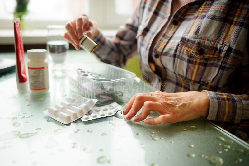 The woman having rheumatoid arthritis takes medicine. royalty free stock photography