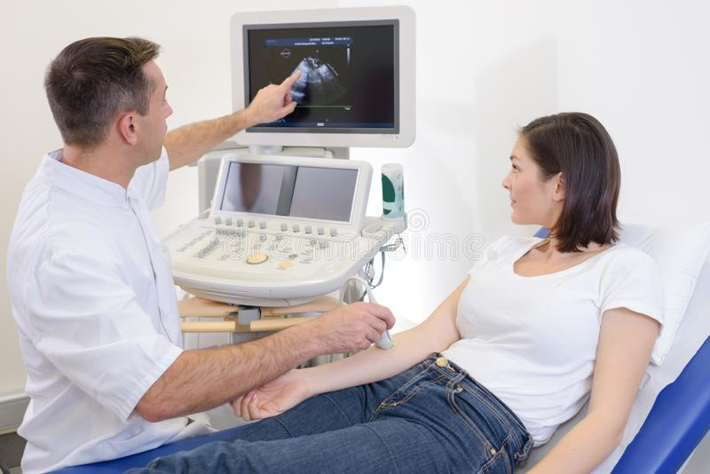 Woman having right arm ultrasound royalty free stock photo