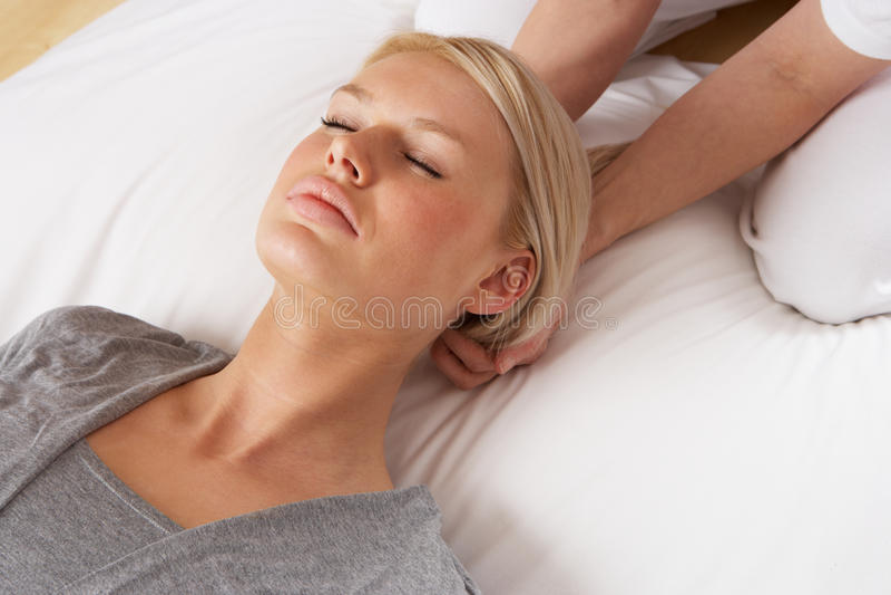 Woman having Shiatsu massage to head stock photo