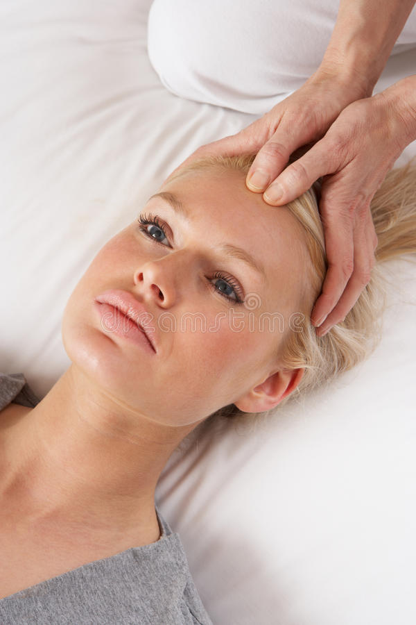 Woman having Shiatsu massage to head stock photos