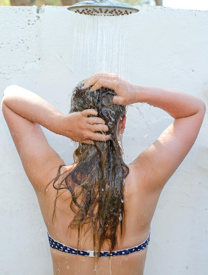 Woman Having Shower Outdoors. Stock Photo