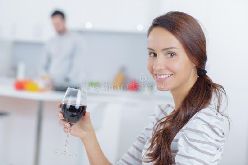 Woman having some wine stock photo