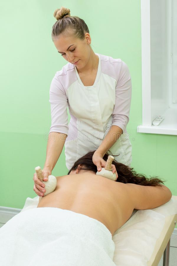 Woman having spa bags massage in wellness salon royalty free stock images