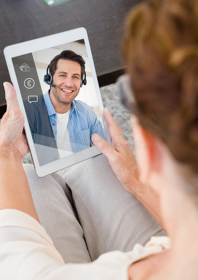 Woman having video calling on digital tablet stock illustration