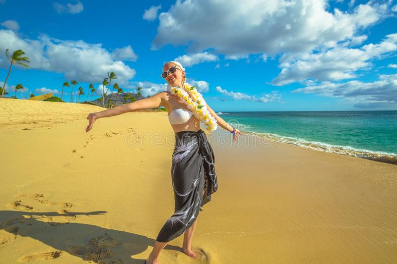 Woman with Hawaiian Lei. Woman with flower neck garland. Freedom bikini woman in Makua Beach, Waianae coast, Hawaii. Makua Valley, Oahu island royalty free stock image