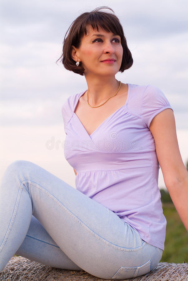 Woman on hay bale royalty free stock photos