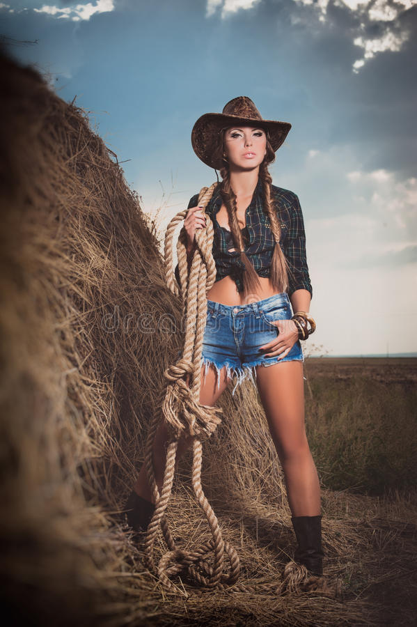 Woman at the hay royalty free stock photography