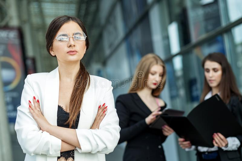 The woman head of the company is wearing glasses. Concept for business, marketing, finance, work, planning and lifestyle royalty free stock photo