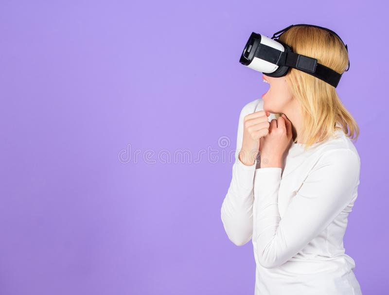 Woman head mounted display violet background. Virtual reality and future technologies. Girl use modern technology vr. Headset. Explore virtual reality. Digital royalty free stock photography