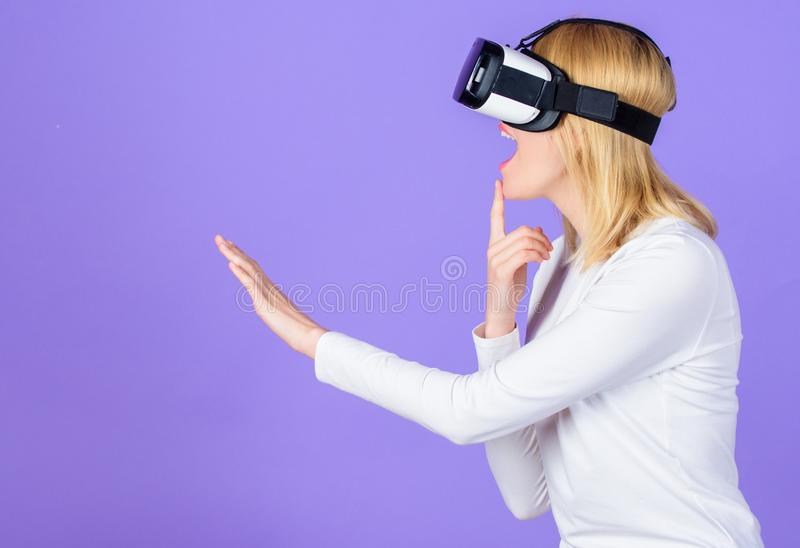 Woman head mounted display violet background. Virtual reality and future technology. Girl use modern technology vr. Headset. Digital device modern opportunity stock images