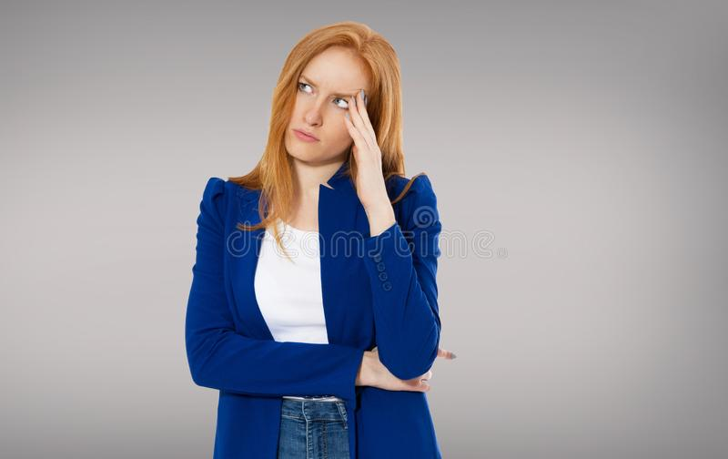 Woman head pain, Female migraine, Unhappy Young Adult Female Wearing Blouse, Hitting Her Head, Eyes Closed, Gesturing She Has Made royalty free stock photos