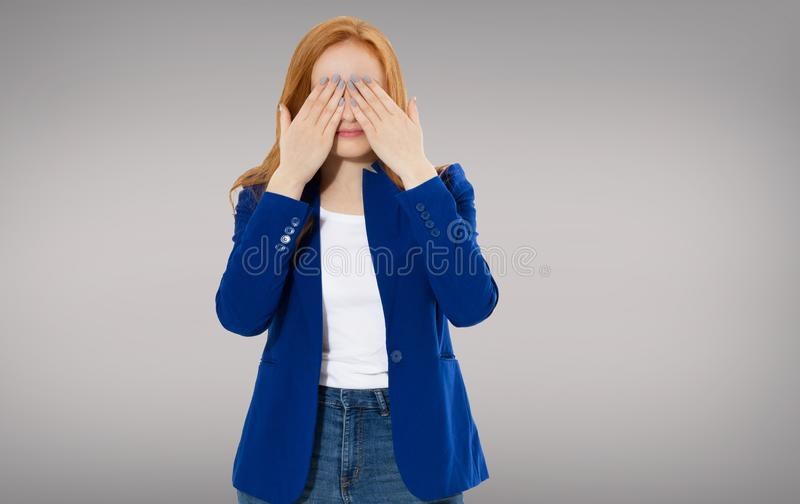 Woman head pain, Female migraine, Unhappy Young Adult Female Wearing Blouse, Hitting Her Head, Eyes Closed, Gesturing She Has Made stock image