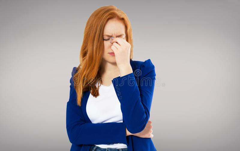 Woman head pain, Female migraine, Unhappy Young Adult Female Wearing Blouse, Hitting Her Head, Eyes Closed, Gesturing She Has Made royalty free stock images