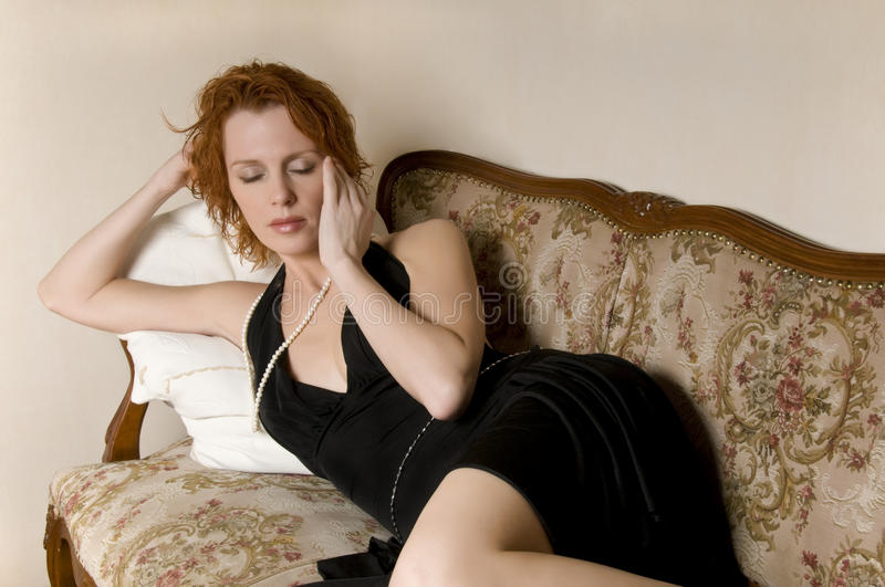 Woman with headache stock photography