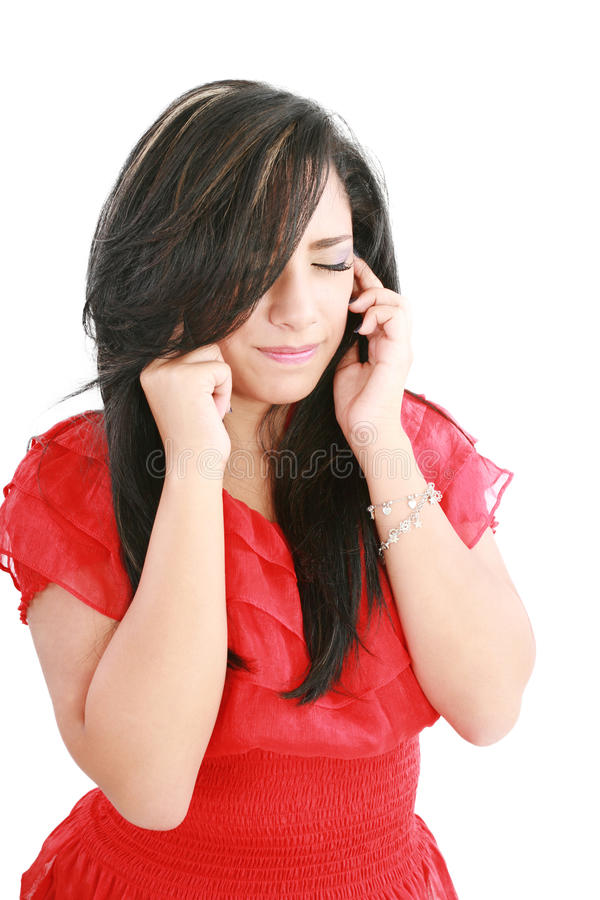 A woman with a headache holding head stock image